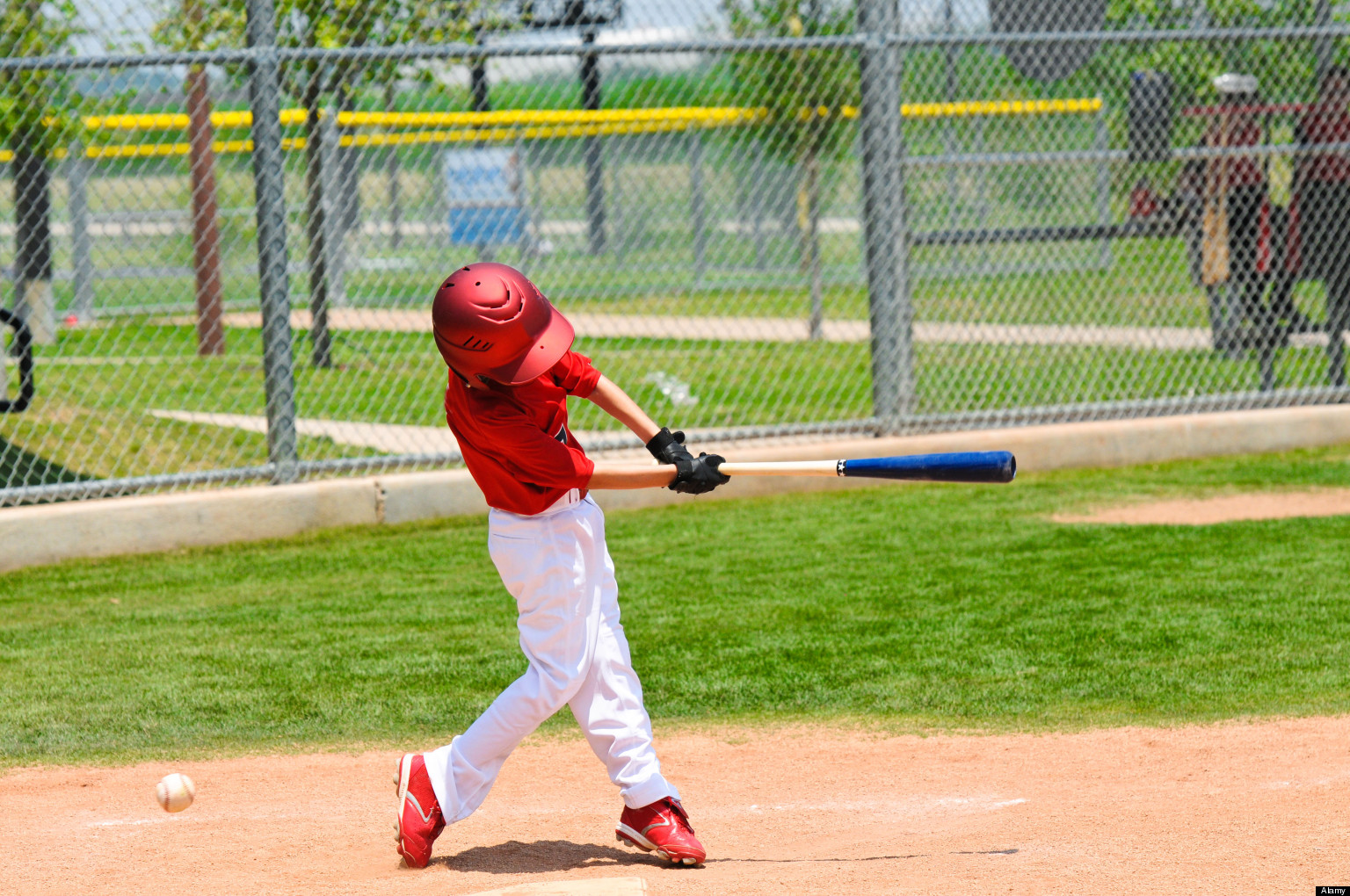 Youth baseball player swinging the bat.